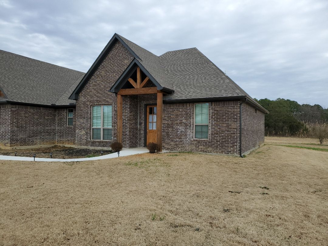 Durant, OK - Installed beautiful new dark bronze gutters by Lankford Roofing in Durant Oklahoma