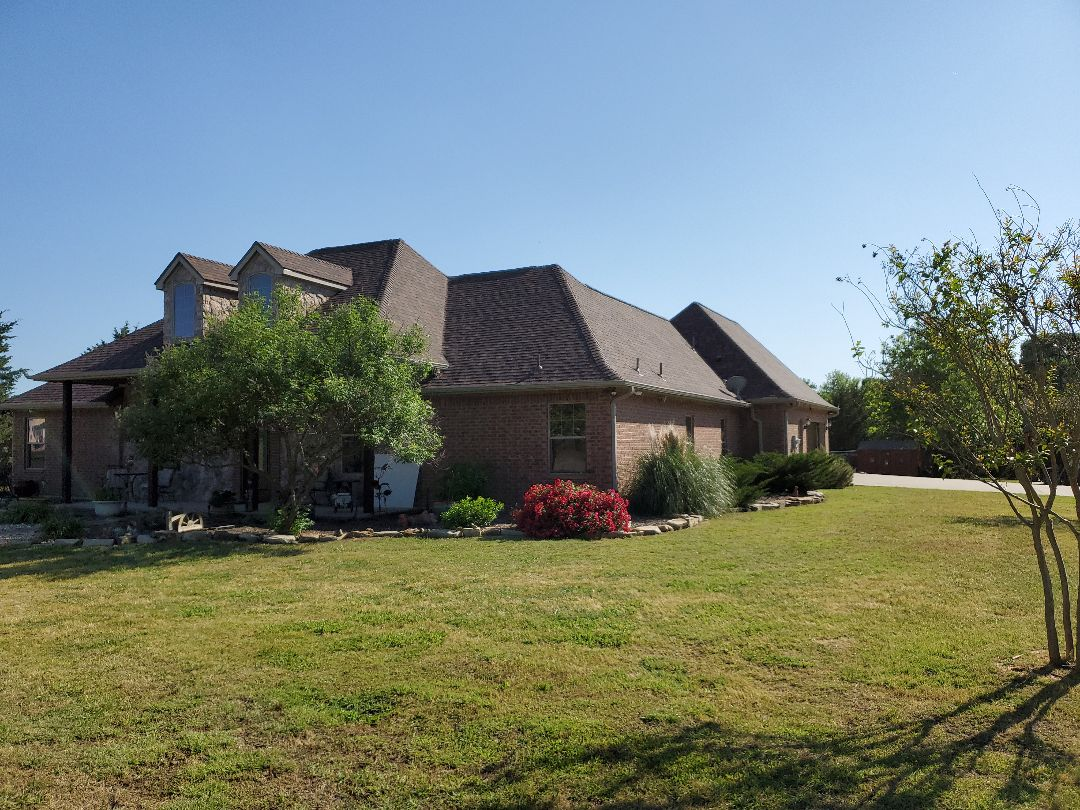 Sherman, TX - Beautiful new Owens Corning duration Brown wood roof with rizzer ridge by Lankford Roofing
