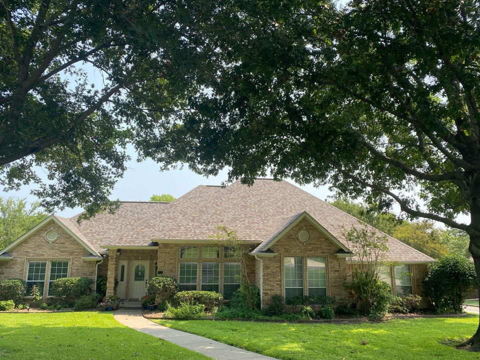 Sherman, TX - Lankford Roofing completed this new reroof in Sherman Texas with Owens Corning Duration Driftwood shingles, new gutters with Gutter Rx and power wash and stain fence