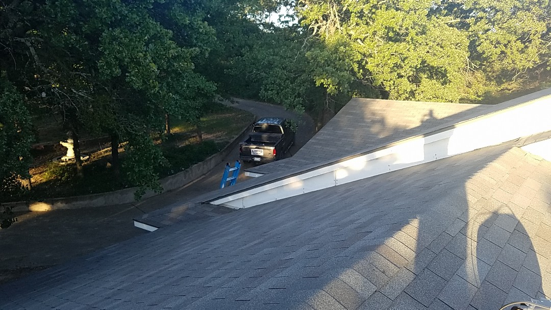 Denison, TX - Replace two shingles on a house in Denison Texas