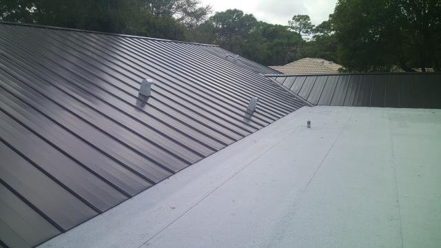 Boca Raton, FL - Dark Bronze Metal roof replacement that ties into Mule Hide flat roof.