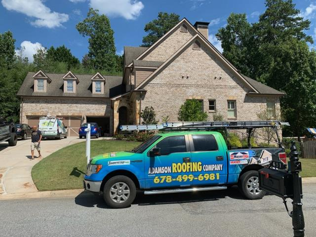 Atlanta, GA - Customer in the process of purchasing this house. He requested a roof inspection be completed before he closes on his house purchase.  Technicians at house conducting roof inspection.