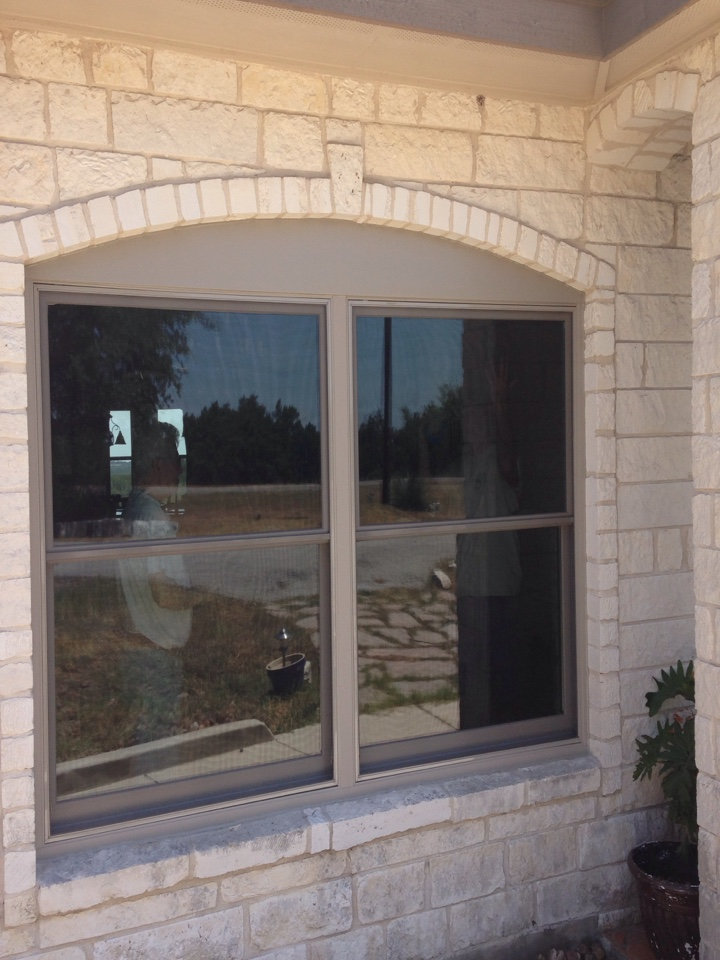 Bulverde, TX - Sandtone double hung windows with coil cap arch