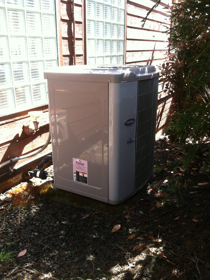 Marcola, OR - Performing a maintenance service call. Heating tune up on a Carrier Heat Pump and Air Handler (Electric Furnace).