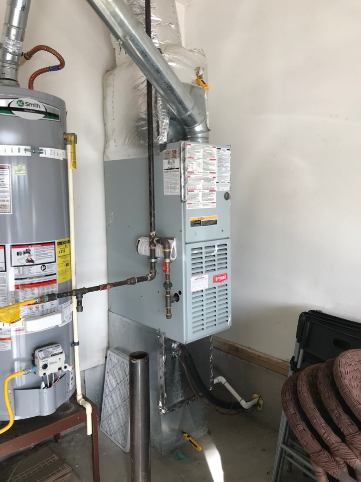 Maintenance on a Bryant gas furnace