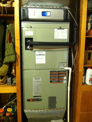 Seal Rock, OR - Performing a PT maintenance service call. Heating tune up on a Trane Heat Pump and Air Handler (Electric Furnace). Install a new run capacitor.
