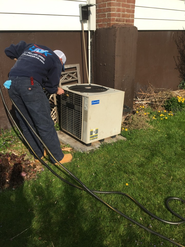 Middletown, CT - Washing the condenser coils, part of spring a/c maintenance