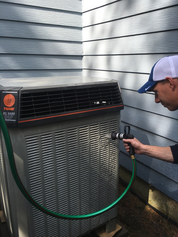 Middletown, CT - Washing down a Trane condenser, this is part of a spring maintenance