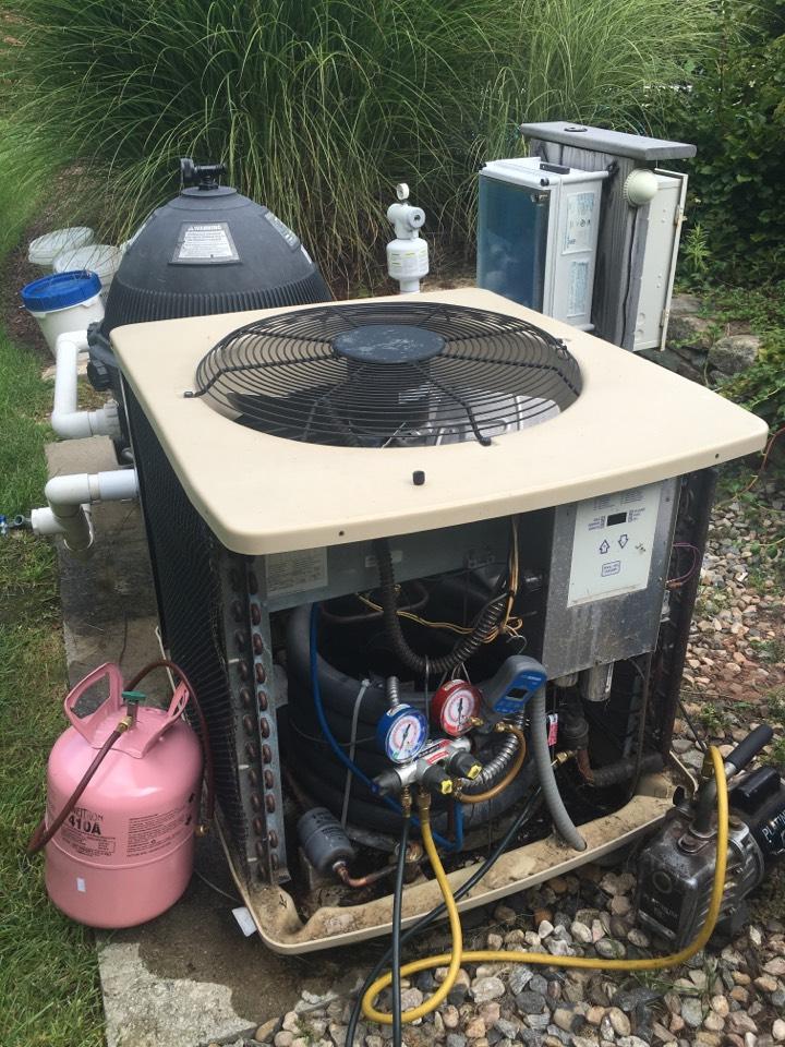 Avon, CT - Swimming pool heat pump repair.