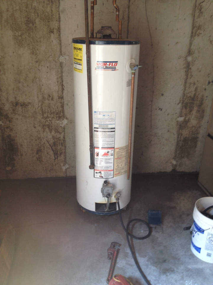 Windsor, CT - Customer called with leaking Mor-Flo hot water heater. Found tank leaking into burner compartment need to replace . Replaced with a 50 gallon a.o. Smith hot water heater
