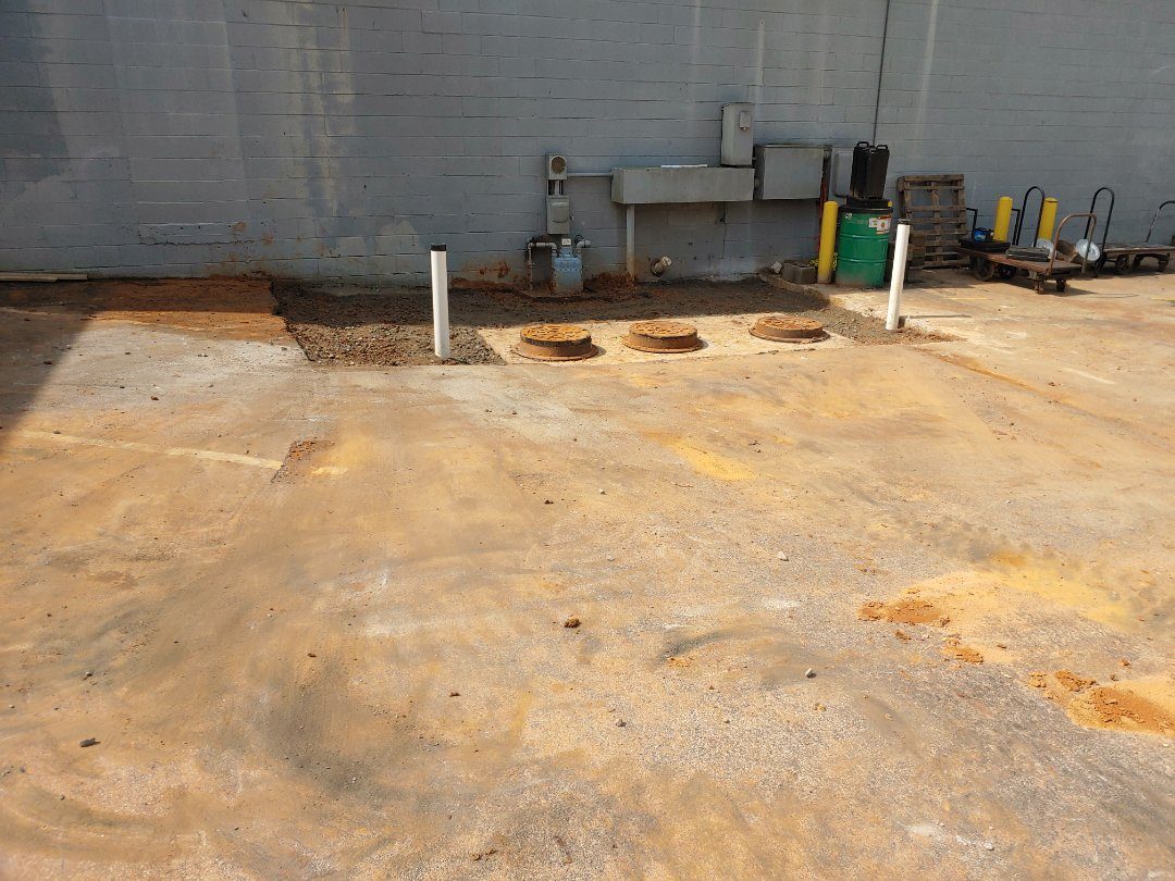 2000 gallon grease trap installation for catering company near downtown Raleigh