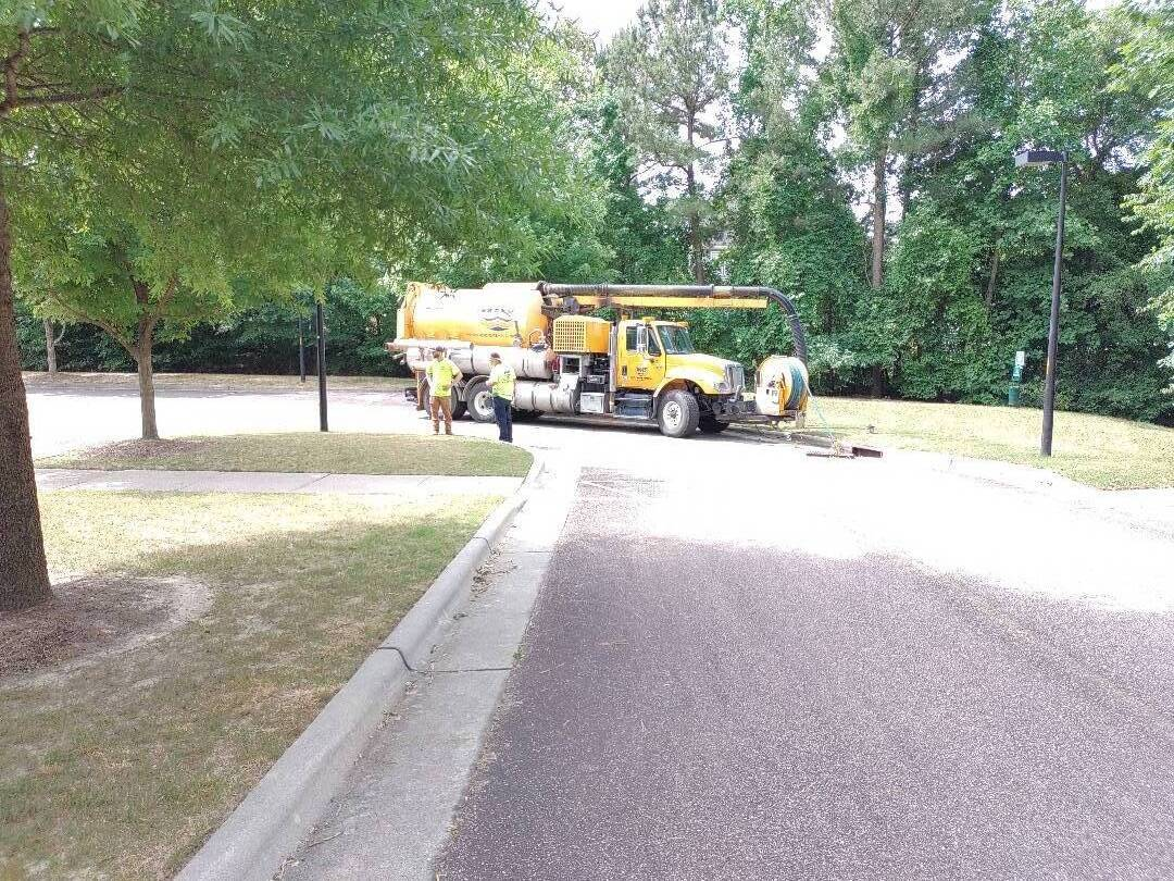 Storm drain cleaning at neighborhood swimming pool