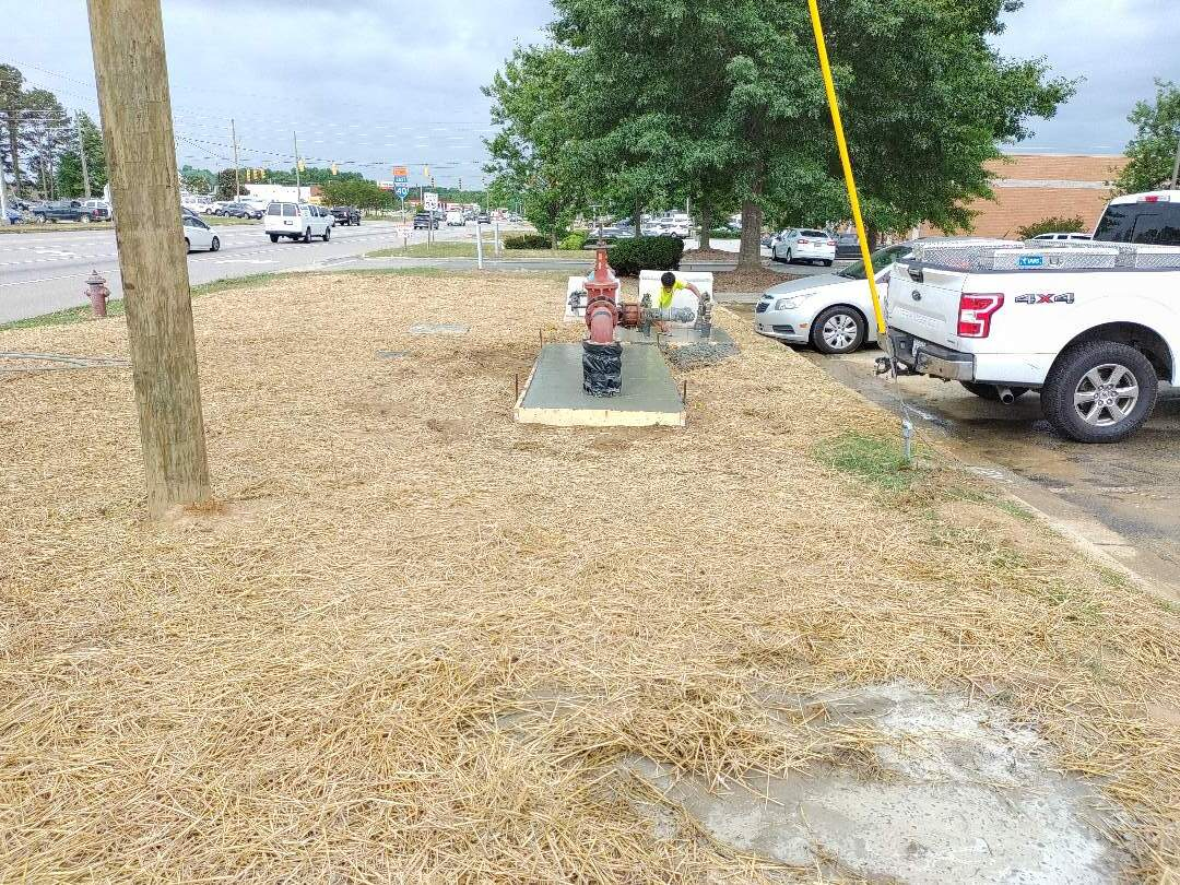 Water meter and backflow relocation as part of the S. T. Wooten NC 42 widening project