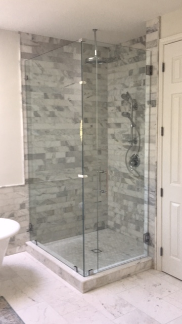 Fort Worth, TX - Noe, Daniel & Trace just completed installation of a beautiful frameless shower enclosure, glass shelves  and custom mirrors.