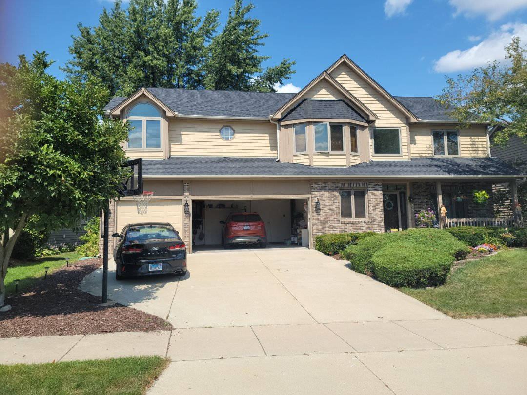 Aurora, IL - Meeting with client to discuss new gutters
