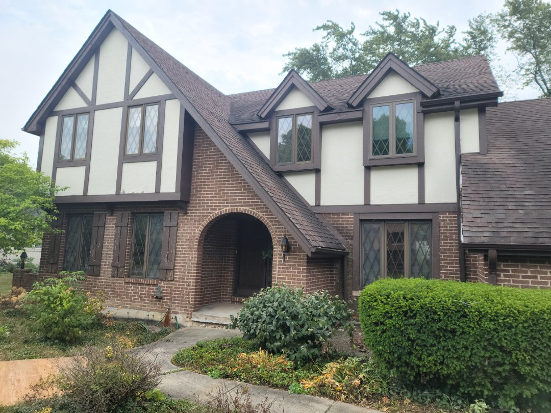 Wheaton, IL - Meeting with client to discuss new gutters, soffit, fascia, and roof.