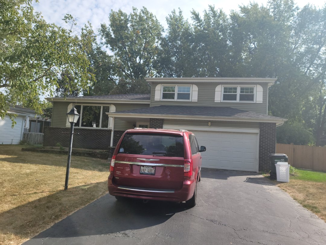 Naperville, IL - Meeting with client to discuss new windows, siding repairs, and small roof flashing patch