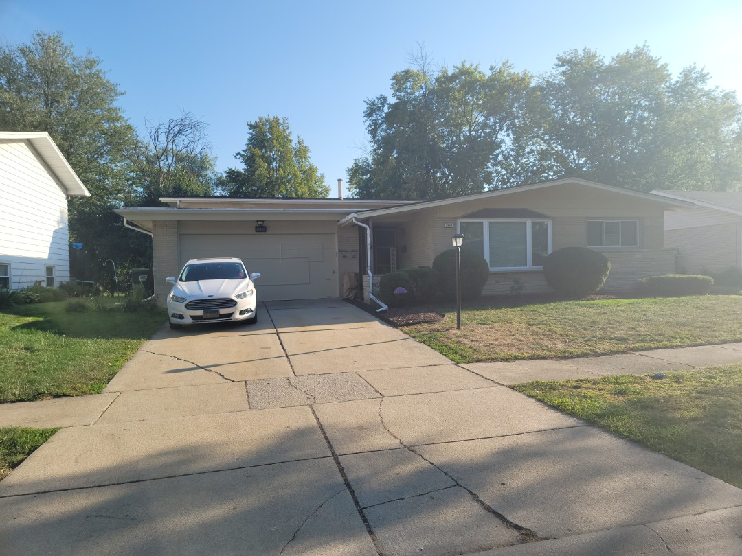 Glenwood, IL - Meeting with client to discuss new gutters, soffit, fascia, roofing, garage and entry door