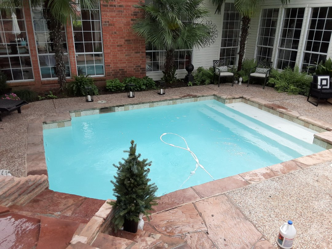 Carrollton, TX - Chemically balancing pool in Carrollton Texas, cleaning out skimmers and pump basket