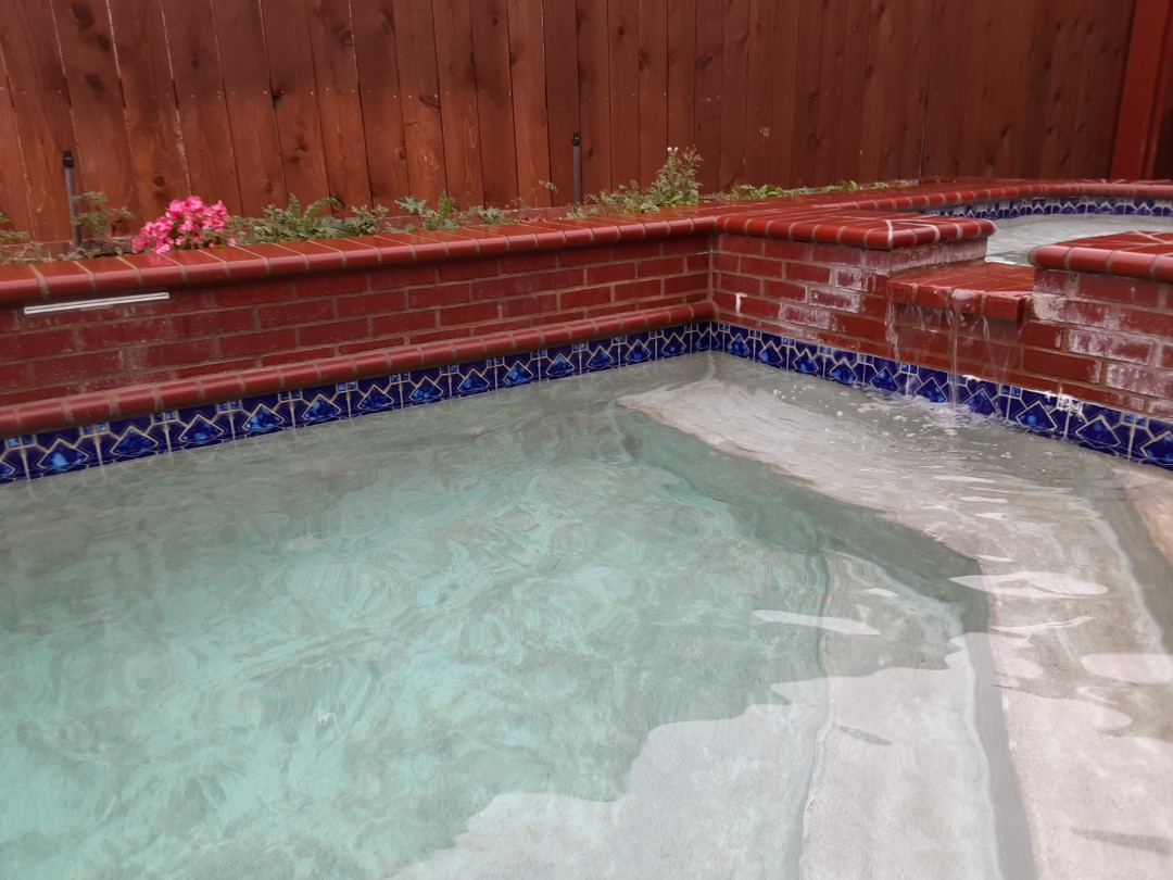 Richardson, TX - Touching up a beautiful backyard pool outfitted with a Pentair FNSP48 DE filter.