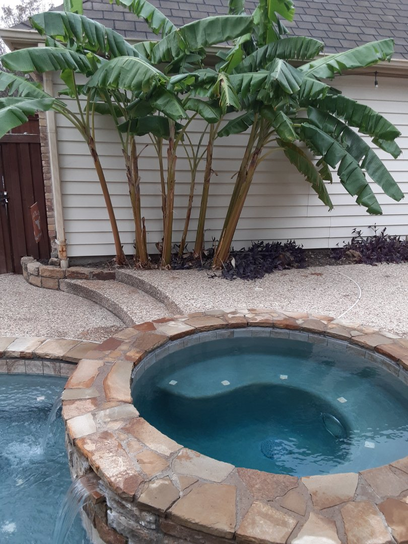 Richardson, TX - An early morning cleaning and maintenance of a residential pool and spa equipped with a Polaris pool cleaner.