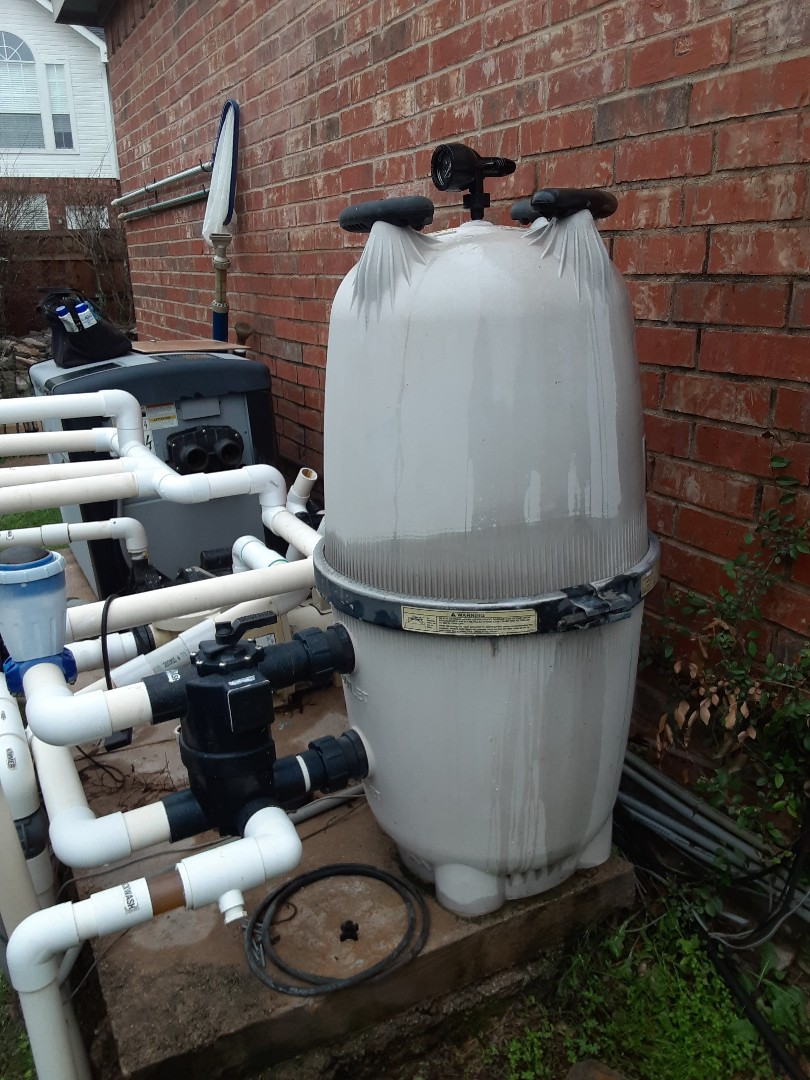 McKinney, TX - An early morning filter cleaning at a small residential pool and spa outfitted with a Jandy DEV60 filter