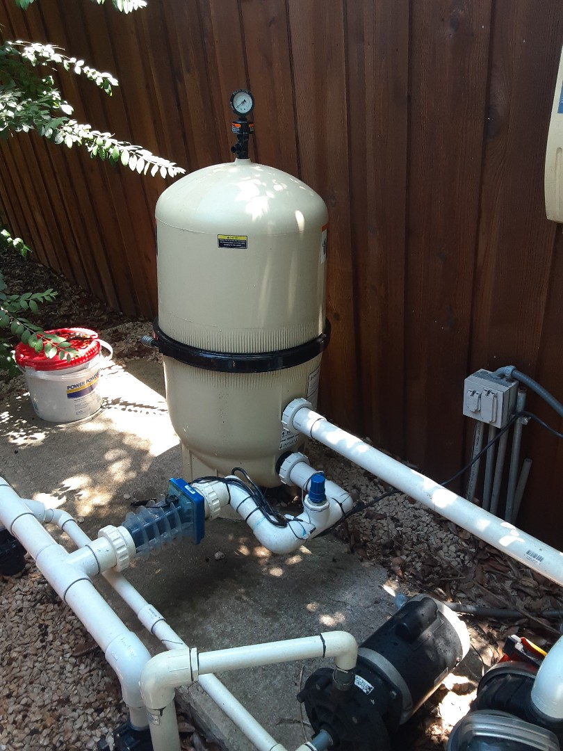 Dallas, TX - Finishing the week with a filter cleaning at a sunny backyard swimming pool equipped with a Pentair CCP420 cartridge filter.