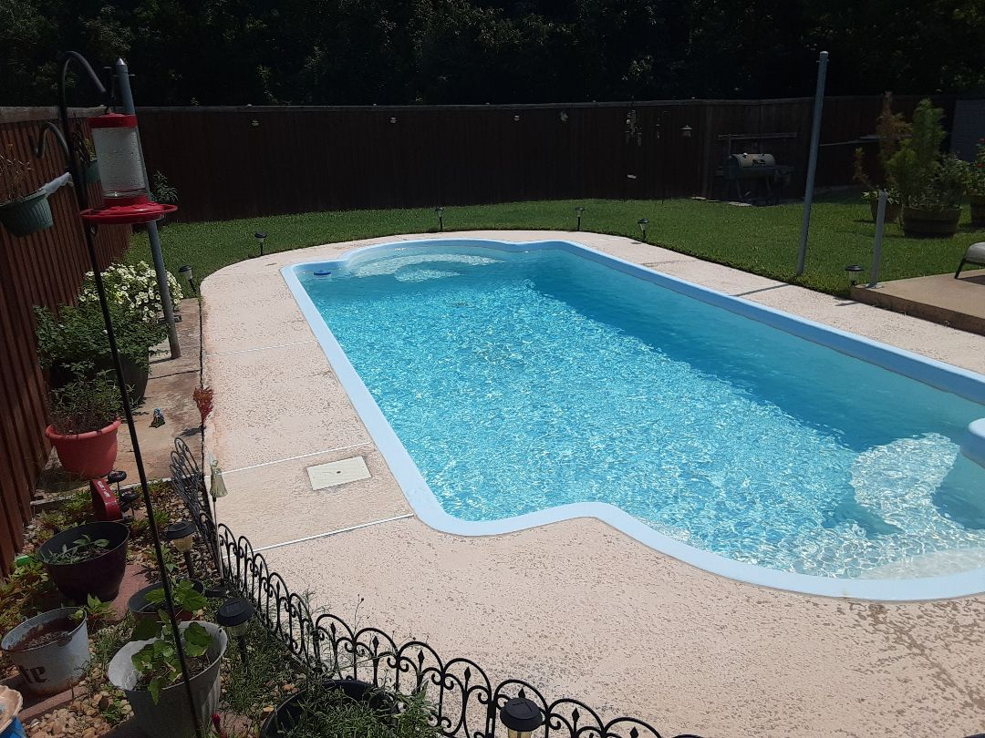Garland, TX - Performing a thorough cleaning of a Hayward DE4820 filter at a sparkling clean backyard swimming pool.