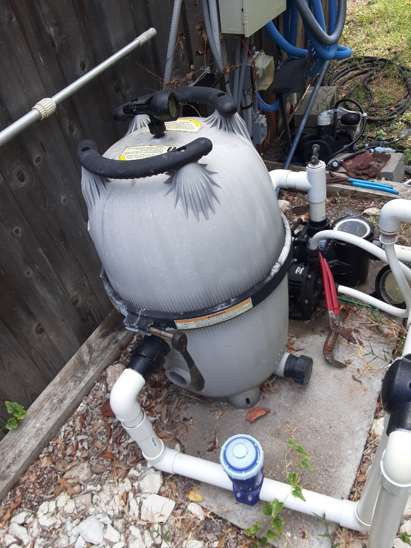 Dallas, TX - Cleaning and maintaining a Jandy CV460 cartridge filter at a peaceful backyard swimming pool.
