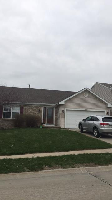 Omaha, NE - Roof replacement and gutter installation.