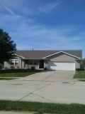 Gretna, NE - New roof, gutters, fascia, and garage door wrap!