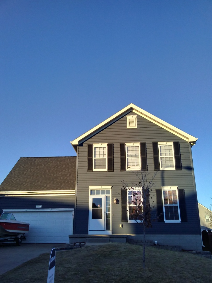 Bellevue, NE - New roof, siding, gutters, and window shutters!
