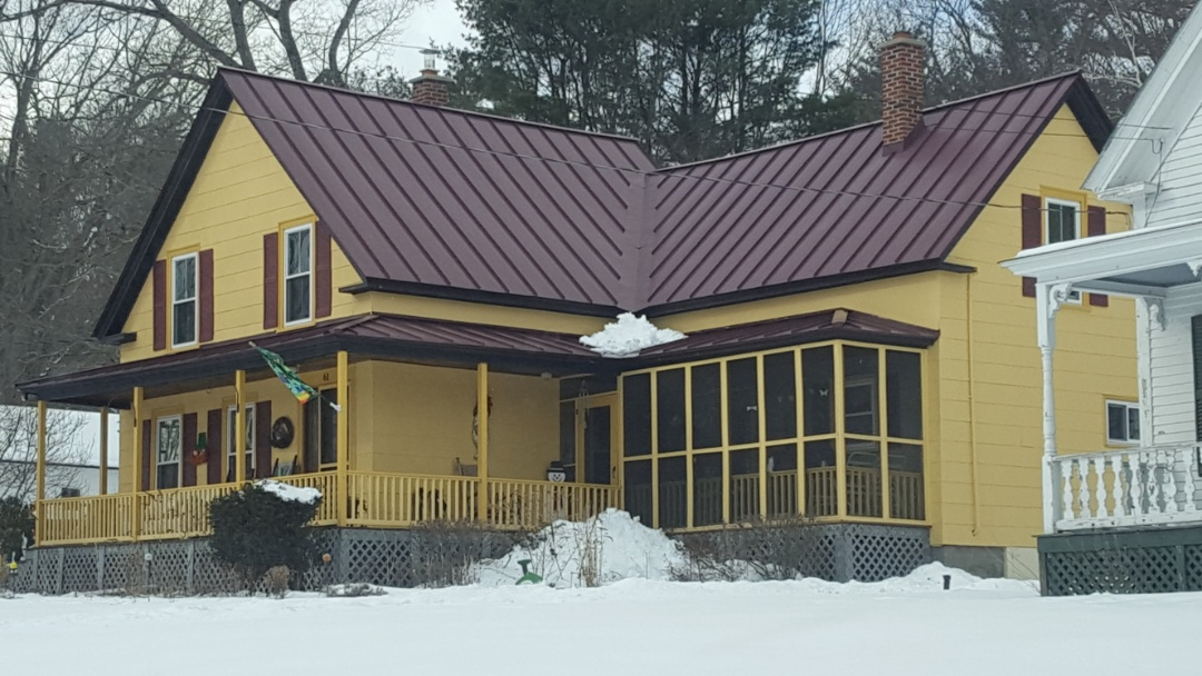 Troy, NH - Syanding seam metal roof on an antique farmhouse.