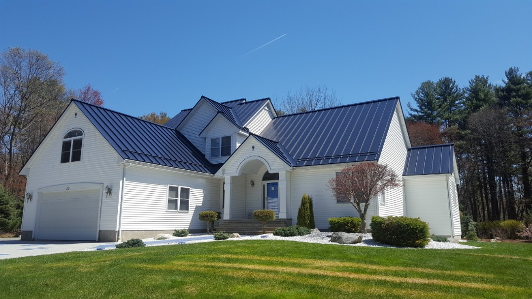 Billerica, MA - Just finished aluminum metal standing seam roof in color Sunnet Blue.
