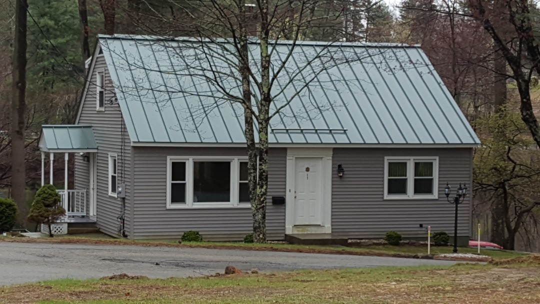Jaffrey, NH - A beautiful aluminum standing seam metal roof on this classic cape style home.
