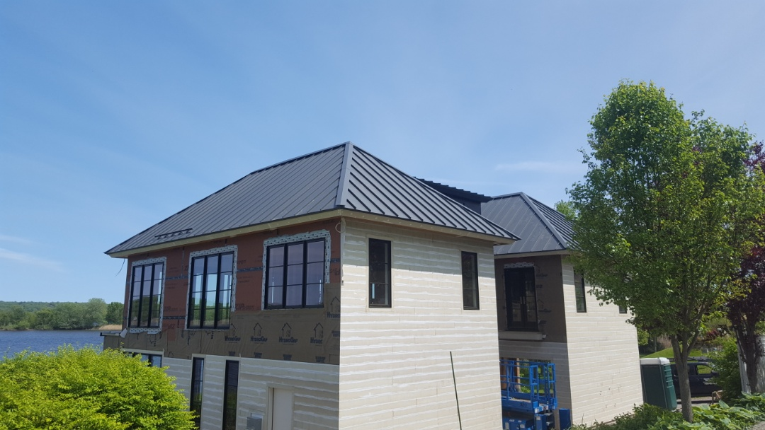 Madison, CT - All done in Essex Conn. New aluminum standing seam metal roof.