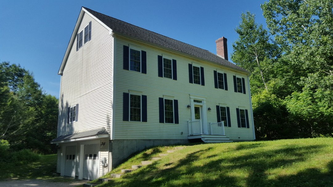 Westminster, MA - The classic two-story Colonial looking to move into a press formed aluminum metal shingle.