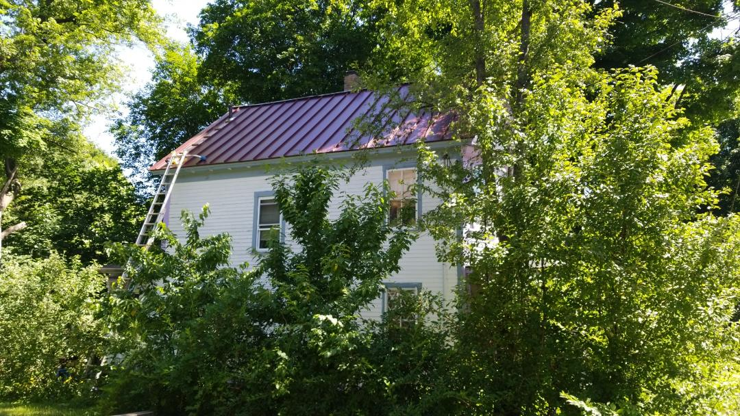 Maynard, MA - Old farmhouse getting new aluminum standing seam metal roof. Great update.