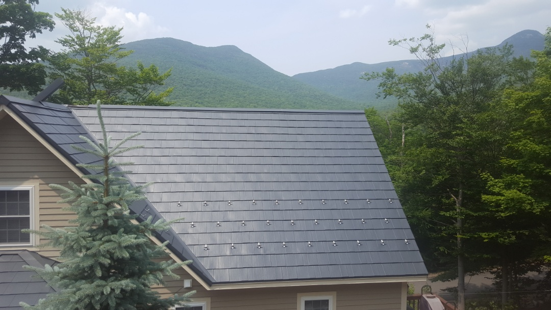 Lincoln, NH - New oxford aluminum shingles color vermount slate ready for winter on LOON mountain in New Hampshire .