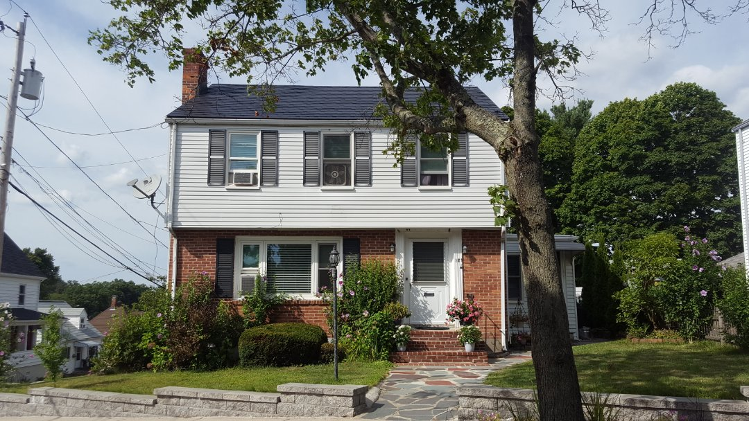 Stoneham, MA - An aluminum metal shingle roof in black.