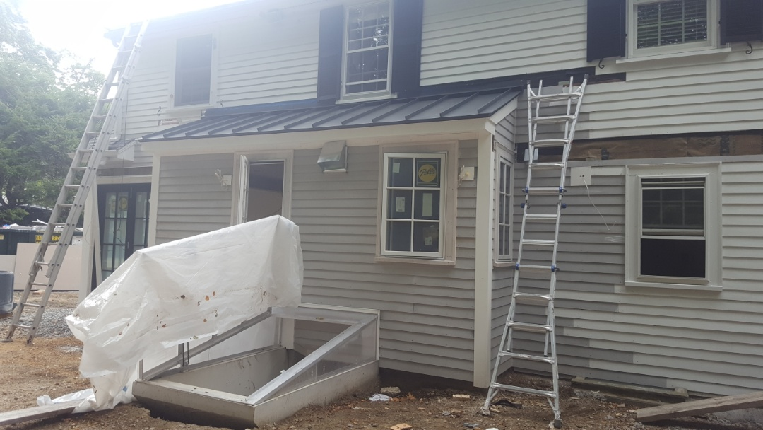 Newton, MA - Shed style roof with aluminum metal standing seam roof in Newton Mass.