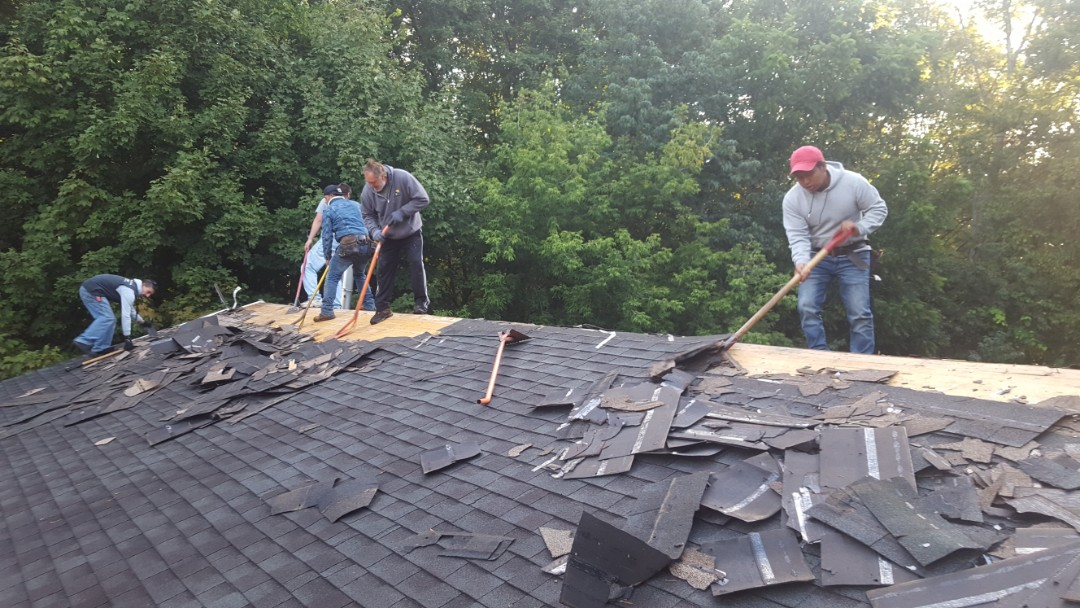 Hopkinton, MA - Just getting started in Hopkinton these,asphalt shingles look terrible