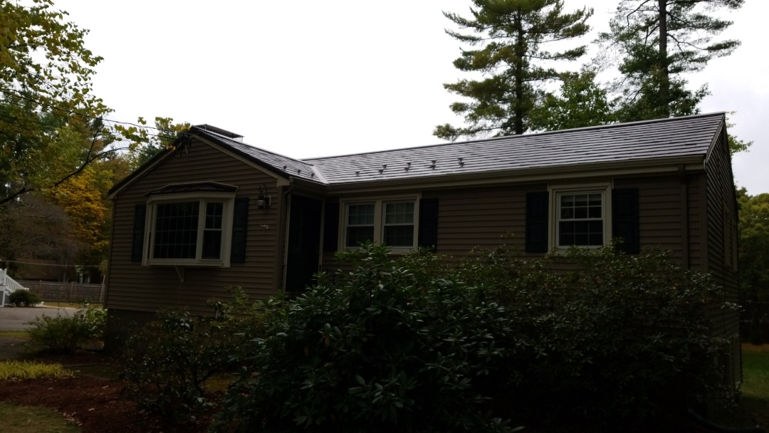Bedford, MA - Beautiful ranch style home. The oxford aluminum slate shingle in mustang brown. Accent roofs on bay windows done in matching aluminum in custom fabricated panels. Meal roofing at its best.