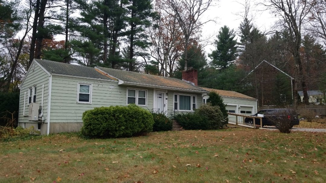 Acton, MA - Ranch house in need of some exterior love. A new metal roof is in it's  not to distant future.