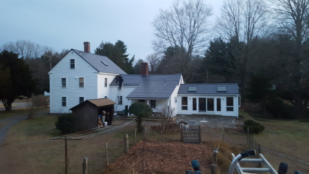 Holliston, MA - Just finishing in time for snow tomorrow. Aluminum metal shingles in Holliston.