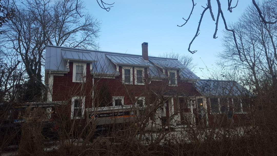 Falmouth, MA - All finished in Falmouth Mass.New aluminum metal standing seam roof