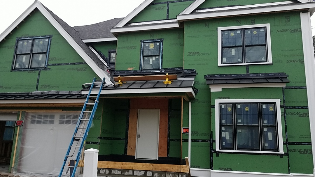 Needham, MA - Standing seam accent roofs in matte black. These roofs are becoming very popular.