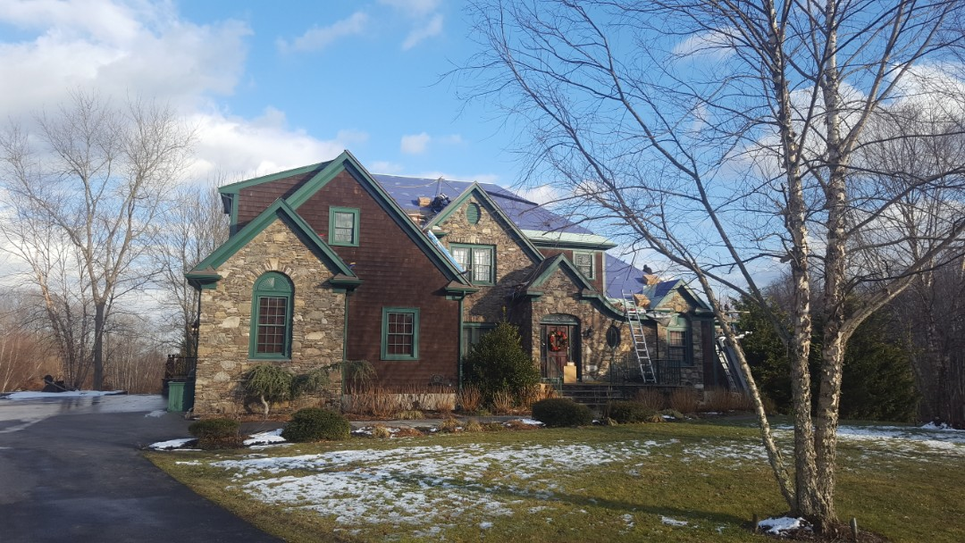 Somerset, MA - Aluminum metal roof being installed.