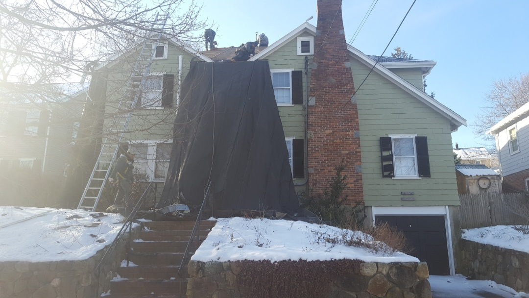 Arlington, MA - First day in Arlington mass.Soon this house will have new aluminum metal shingle roof color pearl black.