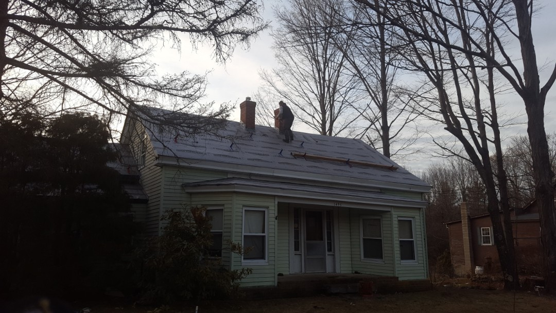 Athol, MA - We removed worn out roof today and dried in roof with paper to keep watertight next week new aluminum metal shingles and aluminum metal standing seam accent roofs